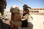 US Navy 080723-M-6065T-003 Hospital Corpsman 2nd Class Doug A. Augustine, a corpsman with Delta Co., 4th Light Armored Reconnaissance Battalion, delivers medical supplies