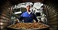 US Navy 080809-N-7981E-082 Culinary Specialist 3rd Class Gabriel Common, from Basile, La., takes pizzas out of the oven in the aft galley aboard the Nimitz-class aircraft carrier USS Abraham Lincoln (CVN 72).jpg