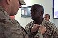 US Navy 080916-M-4937G-054 Chief Hospital Corpsman Lawrence W. Libengood left, pins Chief Hospital Corpsman Cortez Stewart.jpg