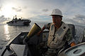 US Navy 080924-N-3595W-024 Chief Boatswain's Mate Carl Lemouis heads for Gonaives to offload disaster relief supplies.jpg