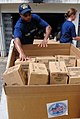 US Navy 090304-N-1688B-157 Seaman Christopher Blandford, assigned to the amphibious transport dock ship USS Nashville (LPD 13), delivers medical supplies donated by Project Handclasp and Project Hope to Effia Nkwanta hospital.jpg