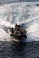 US Navy 091129-N-0260R-003 he visit, board, search and seizure team approaches USS Chosin (CG 65).jpg