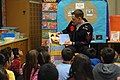 US Navy 100302-N-0718S-095 Cryptologic Technician (Interpretive) 1st Class David G. Burrell reads a Dr. Seuss book to students at George C. Marshall Elementary School during National Read Across America Day.jpg