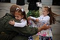 US Navy 100317-N-8590G-004 Lt. Peter Bras reunites with his daughters during a homecoming celebration.jpg