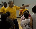 US Navy 100810-N-2389S-029 viation Ordnanceman 2nd Class Javier Keyser organizes kids at a local YMCA during a fitness challenge as part of Chicago Navy Week.jpg
