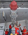 US Navy 100831-N-8490W-001 An aviation ordnance team load a captive-carry MK-84 Harpoon training missile onto a P-3C Orion at Naval Air Station Jacksonville.jpg