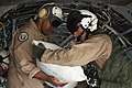 US Navy 100904-M-3497D-990 Rear Adm. Sinclair Harris with a sack of food during a humanitarian supply mission.jpg