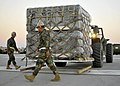 US Navy 100929-N-4440L-091 Seabees assigned to Naval Mobile Construction Battalion (NMCB) 74 weigh pallets during a mount out exercise at Naval Con.jpg