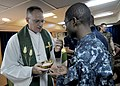 US Navy 101107-N-4743B-056 Cmdr. James Johnson, command chaplain aboard the forward-deployed amphibious assault ship USS Essex (LHD 2), presents co.jpg