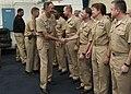 US Navy 101110-N-6062N-067 Vice Adm. Scoot Van Buskirk, center, commander of U.S. 7th Fleet, congratulates 21 newly pinned Information Dominance Wa.jpg