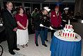 US Navy 101111-N-7948C-026 Marine Maj. Trent Gibson cuts a ceremonial cake during a birthday celebration in honor of Marine Cpl. Jason Dunham.jpg