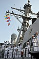 US Navy 110316-N-9818V-141 Sailors man the rails of the Arleigh Burke-class guided-missile destroyer USS Decatur (DDG 73).jpg