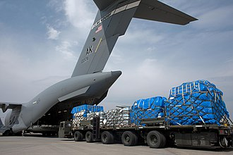 Operation Tomodachi - A C-17 Globemaster is loaded with food, water and blankets at Yokota
