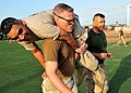 US Navy 110401-N-1755G-522 Fleet Master Chief Bradley LeVault carries Chief Information Systems Technician Joel Ramirez during the Marine Corps com.jpg