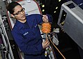 US Navy 110405-N-3154P-155 Damage Controlman Fireman Vanessa Duenas unrolls cable for a sound-powered phone during a toxic gas damage control train.jpg