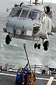 US Navy 110510-N-ZI300-110 Sailors aboard USS Boone (FFG 28) attach a pallet of supplies to an SH-60B Sea hawk helicopter during a vertical repleni.jpg