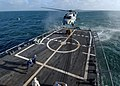 US Navy 110510-N-ZI300-141 Sailors aboard the guided-missile frigate USS Boone (FFG 28) prepare to attach a pallet of supplies to an SH-60B Sea Haw.jpg