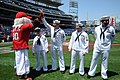 US Navy 110515-N-AD372-286 Washington Nationals mascot Screech high fives Hospital Corpsman 1st Class Andrew Jenkins at the Nationals Park prior to.jpg
