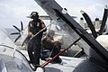 US Navy 110915-N-ZZ999-412 Airman Wellington O'Kene, from Warri, Nigeria, scrubs down an EA-6B Prowler assigned to the Wizards of Electronic Attack.jpg