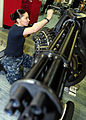 US Navy 111023-N-QL471-080 Aviation Ordnanceman Airman Laticia Workman performs an inspection on an M61A-2 Vulcan 20 mm Gatling gun aboard the airc.jpg