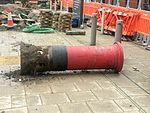 Uprooted post box on Oxford Road, Manchester.jpg