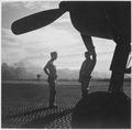 VF-17 ground crewmen await word to ready F4U for takeoff on Rabaul raid from Piva strip on Bougainville. - NARA - 520960.tif