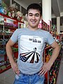 Vendor with Taxi to the Dark Side T-Shirt - Kokand - Uzbekistan (7536156370).jpg