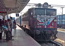 Vijayawada Rayagada passenger with a WAG5 loco at Vizianagaram train station.jpg