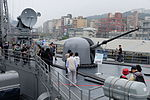 Visitors around OTO Melara 76mm Gun aboard on ROCN Pan Chao (PFG2-1108) 20150316.jpg