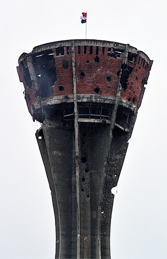 Vukovar water tower during the Siege of Vukovar in eastern Croatia, 1991. The tower came to symbolize the town's resistance to Serb forces. Vukovar water tank.jpg