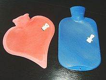 Two Modern Hot Water Bottles Shown With Their Stoppers