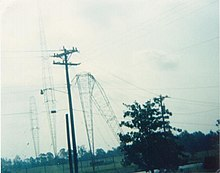 Three transmitter towers, with one bent in half
