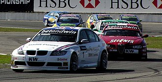 2006 World Touring Car Championship - The BMW 320si of Andy Priaulx leads the WTCC field during race 10 at Curitiba
