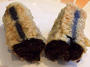 Blood sausage - A single battered deep-fried chip shop black pudding (approx. 20 cm long), sliced open