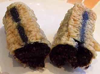 Blood sausage - A single battered deep-fried chip shop black pudding (approx. 20 cm long), sliced open