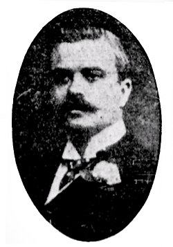 Man with moustache, wearing suit, in an oval frame