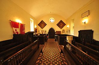 Wolford Chapel - Interior view looking towards the entrance in the west wall