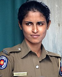 Woman Security Guard at Temple of the Tooth - Kandy - Sri Lanka (14156225823).jpg