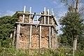 Zicht op kasteelruïne Ouborgh met houtconstructie gestut, deels overwoekerd met planten - Swalmen - 20429616 - RCE.jpg