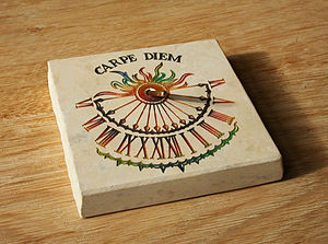 A horizontal sundial with Carpe Diem on it. Fr...