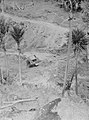 (Long range view of a man driving a bulldozer along a dirt hill) (AM 77380-1).jpg