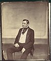 -Seated Man in White Vest and Dark Coat- MET DP111480.jpg