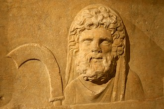 Saturnalia - Bas-relief depicting the god Saturnus with a scythe (Roman, 2nd century AD).