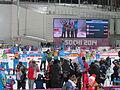 2014 WOG Biathlon Women Relay Flower Ceremony 01.JPG
