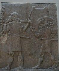 Servants carrying a war chariot-AO 19884