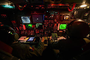 "23d Bomb Squadron - Instructor Radar Navigator Capt. Zac ""Chaos"" Proano (left) and Weapons Officer Capt. Andrew ""Mayhem"" Paulsen conduct a live CBU-87 and CBU-103 training mission on a B-52H Stratofortress Feb. 11, 2014, over the Nevada Test and Training Range."