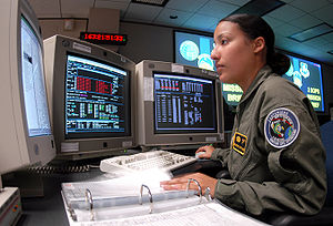 Schriever Air Force Base - Senior Airman Nayibe Ramos runs through a checklist during Global Positioning System satellite operations in 2004.