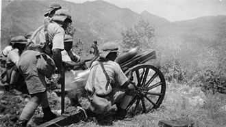 Ahmed Barzani revolt - Mountain gun of the Iraqi Army column, 'Dicol', shelling Shirwan-A-Mazin from a hillside at Kani-Ling during the Ahmed Barzani revolt, June 1932
