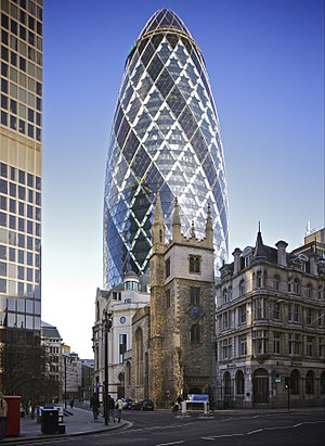 "30 St Mary Axe, also known as ""the Gherkin"", towers over St Andrew Undershaft; modern styles juxtaposed by historic styles is seen often in London. 30 St Mary Axe from Leadenhall Street.jpg"