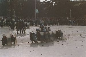 Albanian Civil War - Angry protesters throwing stones at government forces.